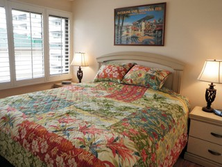 One bedroom with king size bed. Large closet and flat panel TV in room.